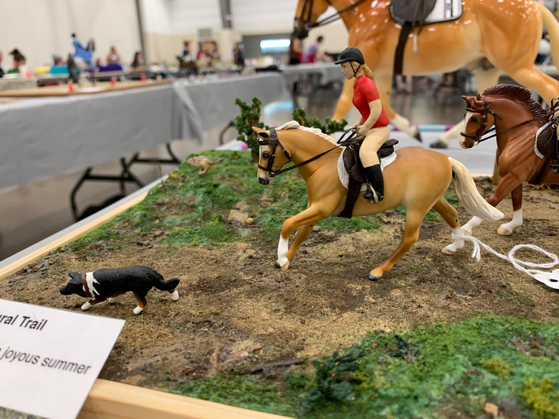 A customized Breyer Stablemate Seabiscuit in outdoor trail riding at The Jennifer Show 2019.